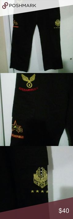 Black cargo pants I am selling a brand new pair of cargo pant with designs. Really cool mens pants. Size 40 royal Pants Cargo