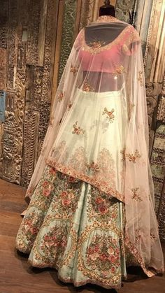 Beautiful mint green and blush pink lehenga with intricate floral thread work and gold zari detailing | Indian Bridal Fsshion | Bridal couture | Bridal lehenga Inspiration | Image source: Pinterest | Every Indian bride's Fav. Wedding E-magazine to read. Here for any marriage advice you need | www.wittyvows.com shares things no one tells brides, covers real weddings, ideas, inspirations, design trends and the right vendors, candid photographers etc.