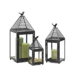 Take a flight of fancy with this charming iron lantern. The latticed roof is topped with a whimsical bird finial, and the four clear glass panels will let light from your favorite candle shine brightly. The weathered finish makes it look like a timeworn treasure. Candle not included