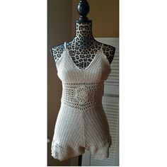 Taupe beige crochet boho romper Beautiful crochet romper perfect for vacations, beach cover ups, or just to wear out! Material is stretchy, lightly lined cups, straps are adjustable. Size small, mannequin is wearing a small. Color is taupe/beige. April Spirit Dresses