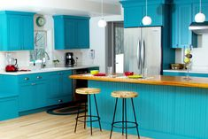 Bold and Blue Cottage Kitchen - eclectic - kitchen - milwaukee - by Dura Supreme Cabinetry Solid Wood Kitchen Cabinets, Solid Wood Kitchens, Blue Cabinets, Kitchen Cabinets In Bathroom, Kitchen Cabinetry, Kitchen Flooring, Loft Kitchen, Teal Kitchen, Eclectic Kitchen