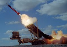Israel intercepted three missiles fired toward the coastal city of Eilat, shortly after launching a response to a mortar landing in the Golan Heights .