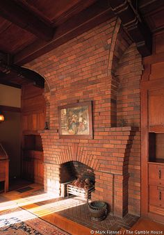 Interior photos of the Gamble House. Detail of Mr. Gamble's den, showing unusual vertical orientation of fireplace and chimney breast.