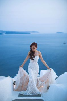 Lace wedding gown with cascading blush train // Robin and Vivien's Romantic Santorini Engagement