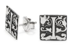 Sterling silver earrings featuring a raised calligraphy detail. £420