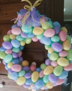 Supplies  Straw wreath   Bag of Easter Grass  I used 5 bags of assorted size eggs  Glue gun and lots of glue sticks  Ribbon  Tie a ribbon and make a loop to hang with.  Leave plastic on wreath. Use glue gun to glue  larger eggs scattered around wreath. Fill in with smaller eggs. Stuff Easter grass in the spots between eggs where the straw wreath show. I found a pony tail holder  in the right   colors and tied it on the top. I also sprayed some glitter on the eggs.