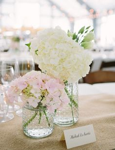Hobnail Jars Scattered Around - Hydrangea Posies | See the wedding on SMP: http://www.StyleMePretty.com/california-weddings/2014/02/27/classic-black-tie-durham-ranch-wedding/ Photography: Annie McElwain