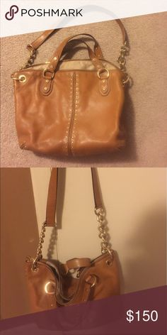 Gently used Michael Kors handbag. Cognac colored handbag with chain detail. Exterior in excellent condition, interior has some minor stains but lining can be recleaned. Michael Kors Bags Satchels