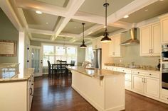 Love this kitchen--the colors, the coffered ceiling, the white cabinets, the lights.....not crazy about granite--maybe light grey or slate countertops is only change