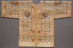Indian  (north India or the Deccan) talismanic shirt, 15th or early 16th century, Ink, gold, and colors on stiffened cotton. Embellished with the full text of the Qur'an and also, in the borders, with the ninety-nine names of God as well as holy sayings, this well-preserved shirt served a talismanic function for the warrior who wore it under his armor protecting him with the Divine Message in battle. Talismanic shirts from Iran, Turkey, and India are rare. W. 38 1/2 in. (98 cm)
