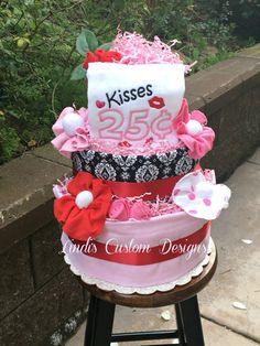 Adorable Valentine Kisses theme diaper cake is stocked with new goodies for the new or expecting mommy and baby! Our diaper cake features 3 tiers and is loaded with burp cloths, baby socks and baby wa