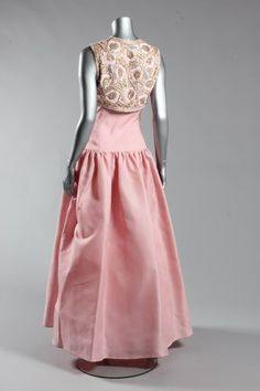 Valentino couture pale pink gazar ball gown with 'jewelled' bolero, circa 1983, Couture labelled, the strapless boned bodice above a full skirt, the organza bolero with cutwork, richly embroidered and beaded with pink and gold flowerheads, sparkling rhinestones