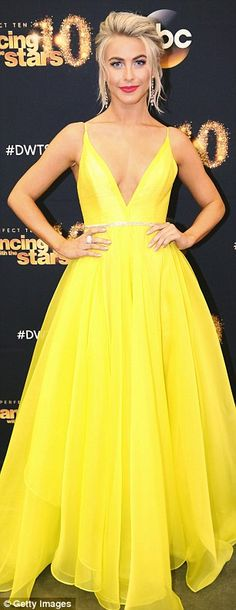 Daring style: The blonde beauty's bold dress featured a plunging front as well as a low-cu...