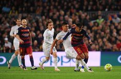 Casemiro of Real Madrid CF battles for the ball with Neymar of FC Barcelona during the La Liga match between FC Barcelona and Real Madrid CF at Camp Nou on April 2, 2016 in Barcelona