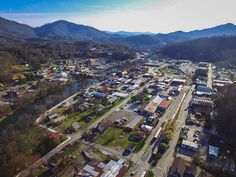 Surrounded by the majestic peaks of the Smoky Mountains, the quaint small town of Bryson City is the perfect vacation getaway destination. Bryson City Nc, Nc Mountains, Mountain Vacations, Our Town, Small Towns, Travel Guides, San Francisco Skyline, North Carolina, Dolores Park