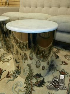 Metal drum table with cream marble top. Measures 18*20. Seen them retail in the $1,000's on modern design website. Two in store at time of posting.