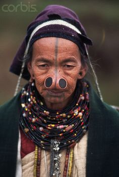 India | Apa Tani women have traditionally worn nose plugs, tattoos which identify them as coming from different regions, and many necklaces. These customs are on the decline.   Ziro. | © Lindsay Hebberd