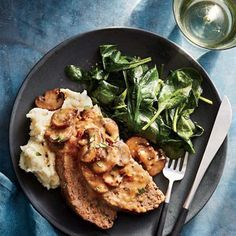 Cremini mushrooms, fresh herbs and whole-grain bread combine forces for a hearty meat loaf that everyone in the family can enjoy. Topped with a simple stock gravy, this meat loaf packs a ton of flavor. We recommend serving it with mashed potatoes and greens. The beef may look a touch pink after slicing, but if a thermometer registers 160°F, it's done. To freeze, cool meat loaf and gravy completely in large ziplock freezer bags and thaw in the microwave. This easy, make-ahead dinner is…