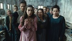Les Mis (2012) | Movie Still: Anne Hathaway (Fantine) and the chorus in Les Miserables.