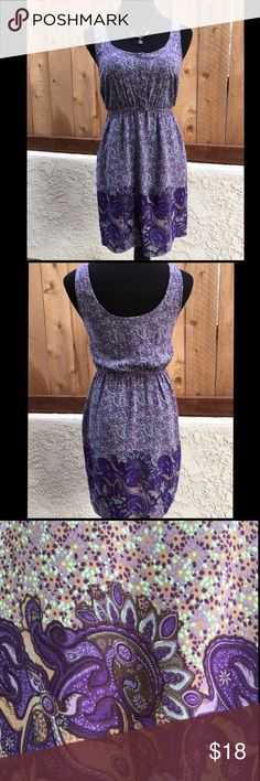"""Purple Akualani Sun Dress Purple, blue & tan sundress with two side pockets  also has a thin elastic waist and five covered buttons. 100% Viscose/Cotton. It is 35"""" long from shoulder seem to bottom of dress. Measurement from pit to pit is 17.25"""". Elastic waist is 13.5"""" wide & elastic stretched is 18"""". In excellent condition. NO spots or damage. Akualani Dresses"""