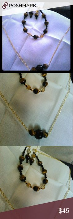 Beautiful genuine tigers eye jewelry set One of a kind hand made stunning tigers eye (genuine) and glass, beaded jewelry set , earrings a bracelet and a bar necklace, gold tone chain and clasps. Handmade by me KJ&E jewelry collection KJE Jewelry