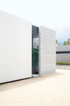 Studio home by Jay Atherton and Cy Keener | Phoenix, Arizona | This urban house is ultra-clean and contemporary in its style, featuring a facade of sandblasted masonry and Ferrari shade sails on its steel frame. When illuminated from inside, the opaque screens turn, provide silhouettes of what's indoors. Minimalist interiors are perfectly in-line with the exterior. Floor-to-ceiling glass walls flood the predominantly white rooms with natural light and enhance their sense of space.