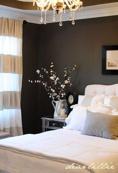 Master Bedroom ideas...like the dark wall with the lighter bedspread and decor
