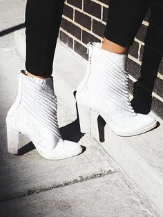 Barleda Heel Boot | Luxe textured leather ankle boots featuring pleat detailing and a pointed toe.  Distressed stacked heel and sole.  Exposed back zip for an easy on/off.