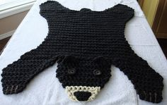 This is a made to order item. This bear would take ten days to two weeks to make. Handmade crocheted black bear rug is made from two strands