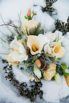 Winter wedding flowers - the silk flower bouquet I had made for our wedding survived a snowy winter anniversary shoot.