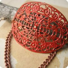 Colorized and manipulated filigree to form a bracelet top.  Tangerine Tango....did you know this color is the Pantone color of the year for 2012?