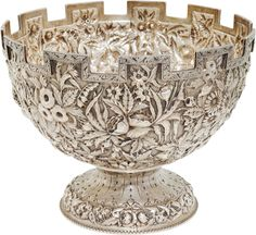 Samuel Kirk & Son coin silver repoussé punch bowl, in a castellated design, c1865. Former Confederate President Jefferson Davis traveled to Macon, Georgia in October 1887 with his wife and his daughters, to attend the Georgia State Fair and a Confederate veteran's reunion, where they were presented with this bowl. Five-thousand Confederate veterans marched past the aging Davis and he tearfully took their salute. Jefferson Davis would die in 1889.
