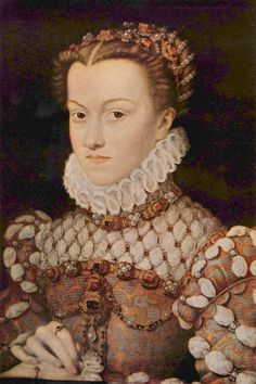 """1570 Elisabeth of Austria by François Clouet Norris has a brief write-up about this portrait on p.563 of Tudor Costume and Fashion (1997 Dover re-issue): """"The sleeves... are trimmed with spiral puffings trimmed with jewels.The bodice and skirt are set of a delicate patterned brocade edged with embroidery; and the skirt is open up the front to show an under-skirt of plain silk. A profusion of jewels ornaments the coif, neck, bodice, waist, and sleeves."""" She was fond of hair with a vee…"""