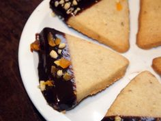 "Savory Shortbread Acorns : ""A combination of sweet and savory spices added to my grandmother's shortbread cookie, dipped in chocolate and topped with toasted pine nuts and dried apricot."" — Peggy Lunde   If you like these, try Claire's Classic Shortbread Cookies."