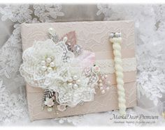 Ivory Guest Book Pen Set Wedding Lace Book Signature Book Birthday Guest Book Brooch Book Flower Jewelled Guest Book in Ivory, Champagne Collection Elegance  This book has been covered with a layer of satin fabric another layer adorned with a gorgeous lace. This piece has been detailed decorated with a wide line of shabby lace, handmade flowers, sparkly brooches and my stamens accents.. Wedding Guest Pen with a Sparkly Brooch Size 6,5x0,5 inches (17x1,8cm)  Options: - Single regular book…