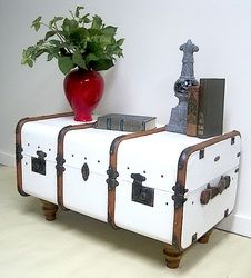 Old steamer trunk repurposed into coffee table