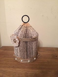 Birdcage book art. With a rustic/vintage sheet music theme.