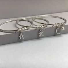 Dazzling rings to pop the question with. Personalised presents to say a special thank you with.Leila works with lots of… Bangles, Bracelets, Bridesmaid, Jewellery, Bridal, Band, Rings, Maid Of Honour, Jewels