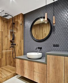 When your bathroom style is on point Double tap ❤️ if you love those hexagonal tiles and feature timber tiles and cabinetry…