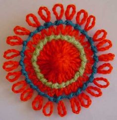 Written directions and video direction on post---A loomed flower decorated with knot stitch