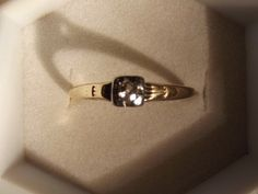 Genuine 14 kt with a 14kt white gold top: This beauty is Genuine 14 kt with a 14kt white gold top that holds a small petite diamond. I did test this diamond and it did read positive for diamond. size 8...