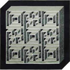 Labyrinth Walk Pattern - supposed to be a 2 block wonder. Pattern is available from American Quilter. Alex might like this, it is stunning in blue.