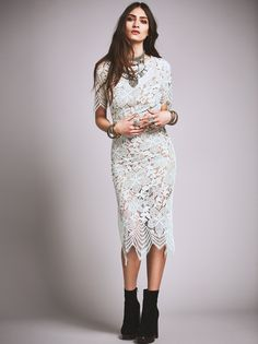 Luna Maxi Dress | Beautiful and delicate floral lace maxi dress featuring an uneven eyelash lace trim. Open keyhole in back. Lined with a removable half slip.