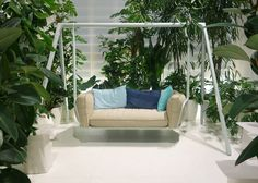 Swinging Sofa on Dezeen...how could anyone get in any work done with this in the office!?