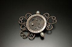 Brooch | Lynette Andreasen. Sterling silver, damascus steel, freshwater pearls