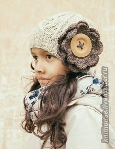 Knitted aran hat with flower