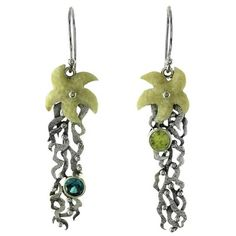 Sterling Silver Fossilized Walrus Ivory Starfish Blue Topaz and Peridot Dangle Earings by Zealandia