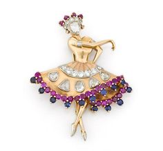 A diamond, ruby and sapphire ballerina brooch