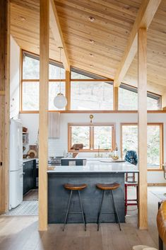 wood kitchen with marble topped island in malibu hills. / sfgirlbybay