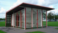"""Prefabricated petrol station by Jean Prouvé, architectural exhibit, Vitra company premises, Weil am Rhein, Germany. The station contains a Prouvé """"Standard chair"""" and a Prouvé table"""